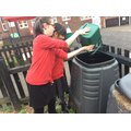 Putting our fruit and vegetable waste into the compost bin.