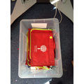 This is the home time box where children put their school jumpers/cardigans and book bags
