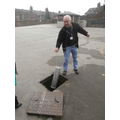 Mr Flynn carefully lowered the time capsule down