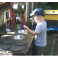 We cook up a storm in the mud kitchen!