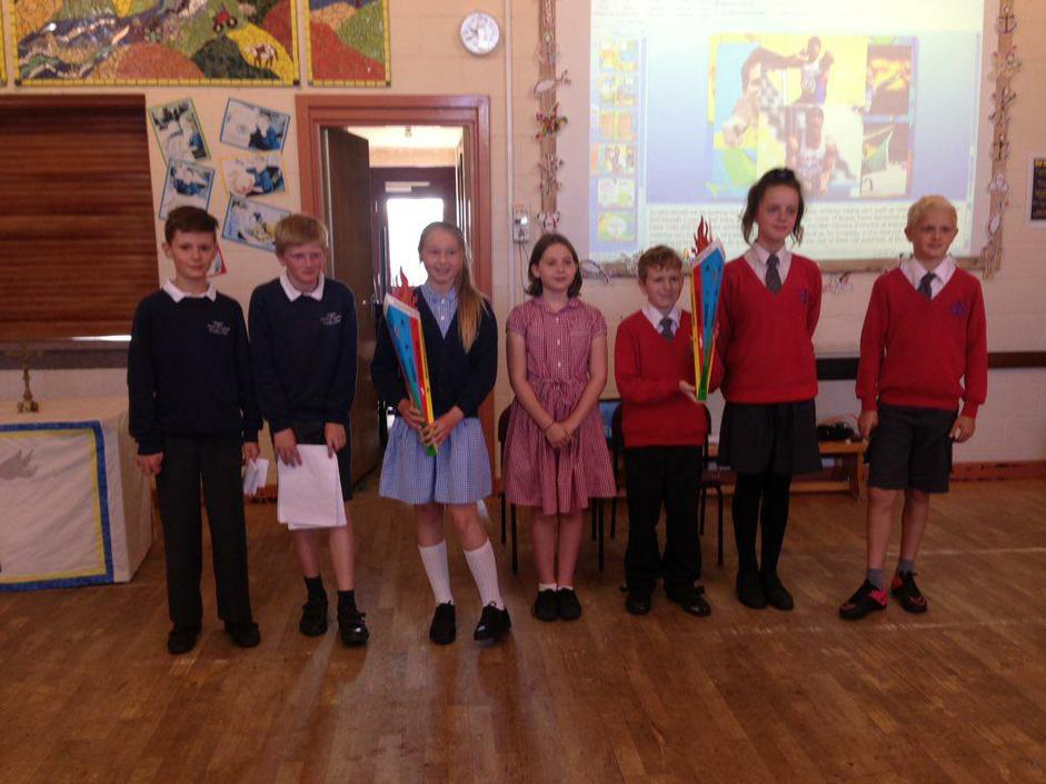 Claypole receiving the torch from Holy Trinity