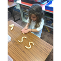 We are developing our ability to hear sounds in words and form the letters ourselves.