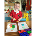 We have been manipulating our Numicon shapes to make pictures.