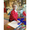 We have been exploring Numicon shapes and trying to fill the Numicon board.