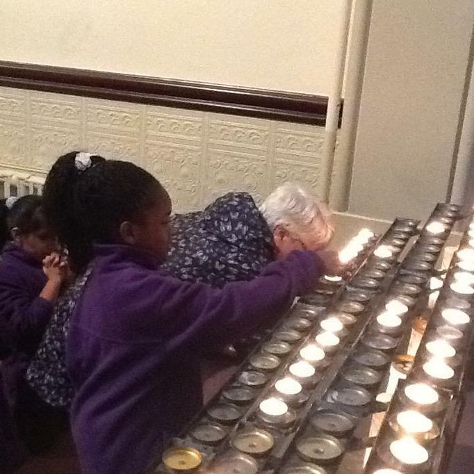 R lighting a candle