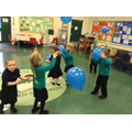 Chasing the balloon around the hall