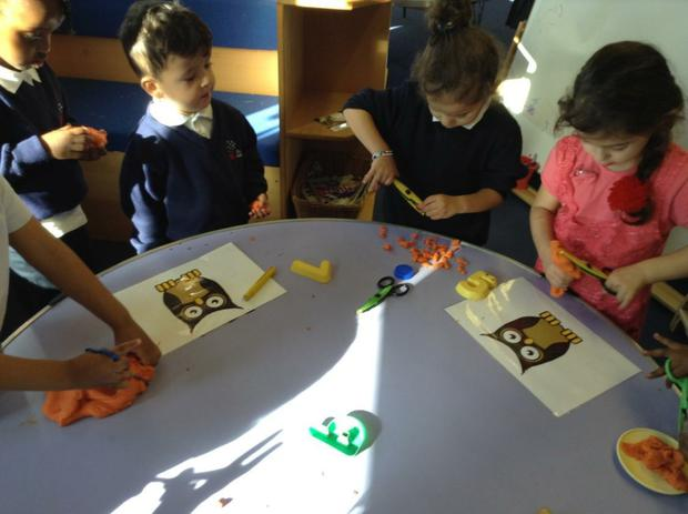 We are learning how to use scissors to make some food for our owl babies