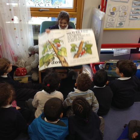 Reading a story to her class.