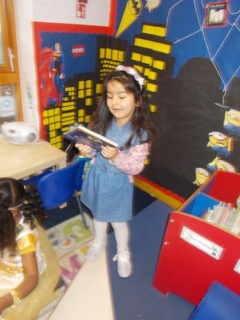 We are learning to choose and look at books in the reading area