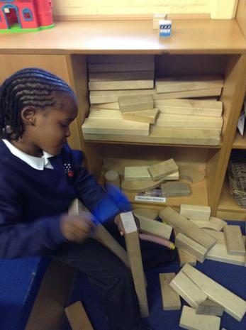 We love constructing with the wooden blocks