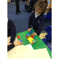 We have been using 2d shapes to make pictures.JPG