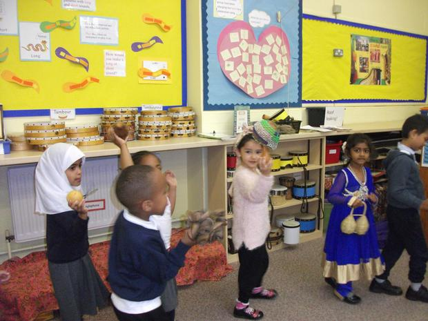 Reception dancing with instruments to Kenyan music