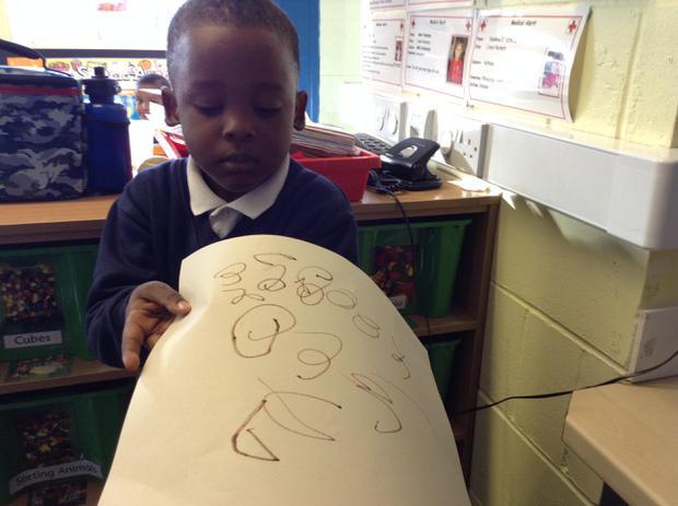We are beginning to mark-make in nursery