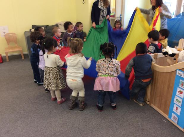 Children playing with the parachute