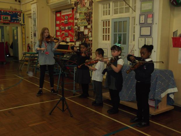 Year 1 watched the violin tutor and some of year 2 play their violins. Would you like to learn