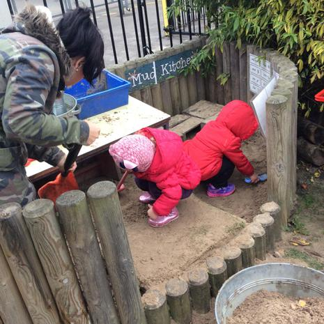 We have been scraping, patting and pressing the mud in the mud kitchen