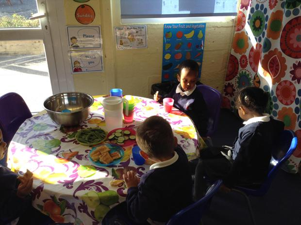 We are learning to talk to our friends at the snack table
