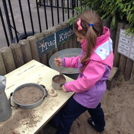 We have been cooking cakes and pies in the mud kitchen