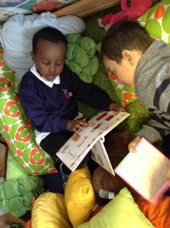 We enjoy looking at books in our reading area