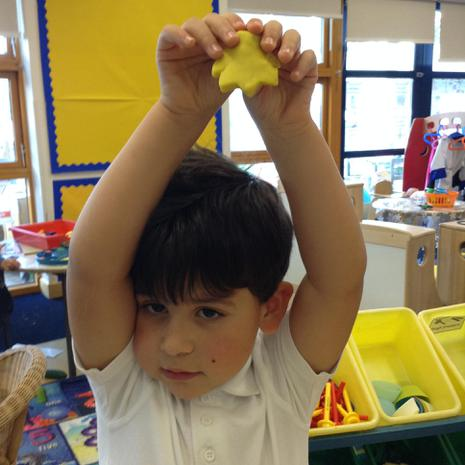 We are learning to make different shapes with play-doh and cutters