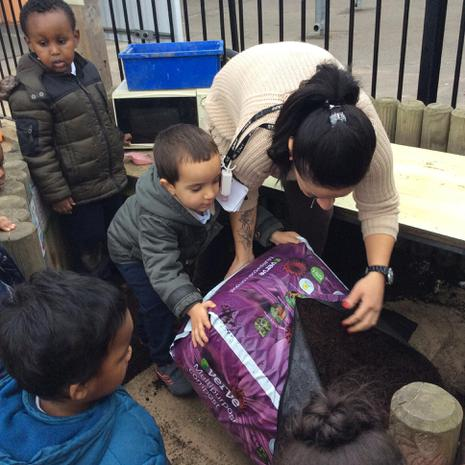 We have been using our muscles to help our teachers lift soil for the mud kitchen.