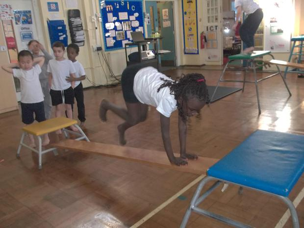 In P.E we are looking at moving using different body parts.JPG