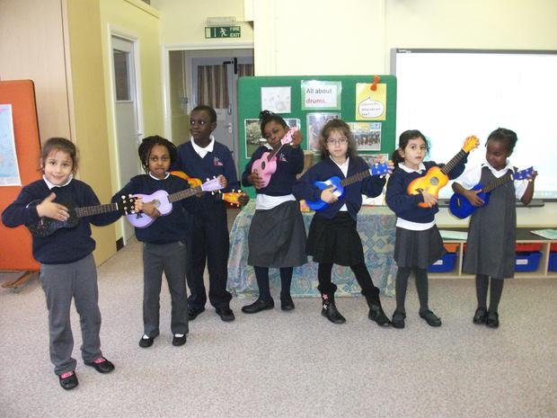 Music club are learning to play the ukelele