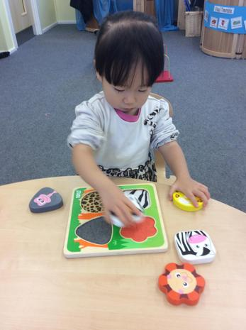 A child concentrating on a puzzle