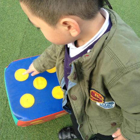 We are learning to recognise dots and numbers on a die