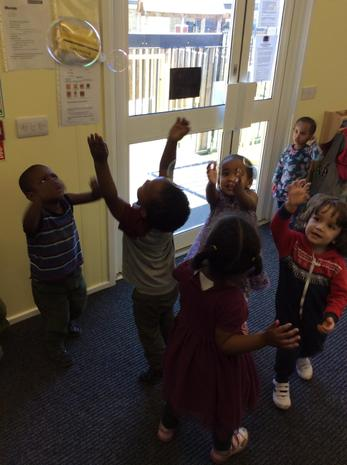 Children are enjoying bubbles.