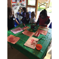 Green class have been painting their first pictures.JPG