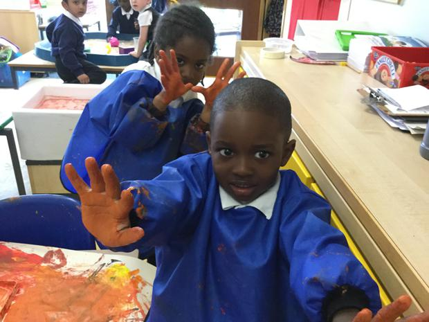 We love making handprint patterns with paint!