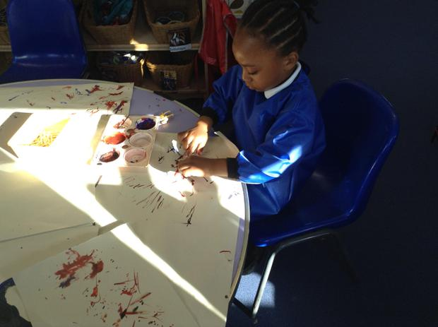 We are learning to use the muscles in our hands by painting with small match sticks