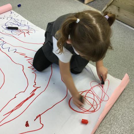 Erin is drawing big circles.