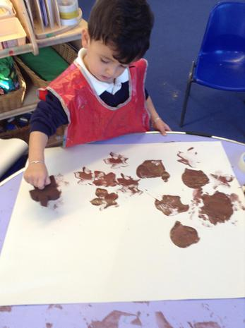 We have been learning to wear our aprons during messy play