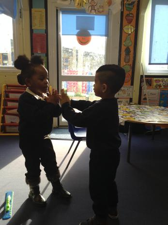 We are learning to play clapping games with our friends