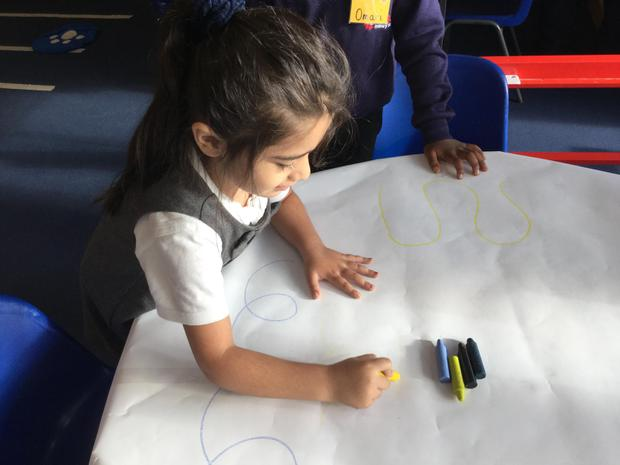 We enjoy free-writing on the graffiti table, which helps develop our muscles for writing..JPG