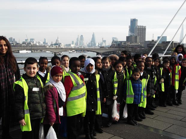 Red Hots learn about some of London's buildings  from Hungerford bridge over the River Thames.JPG
