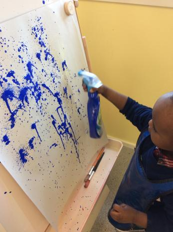 Using a spray bottle to make a picture with paint