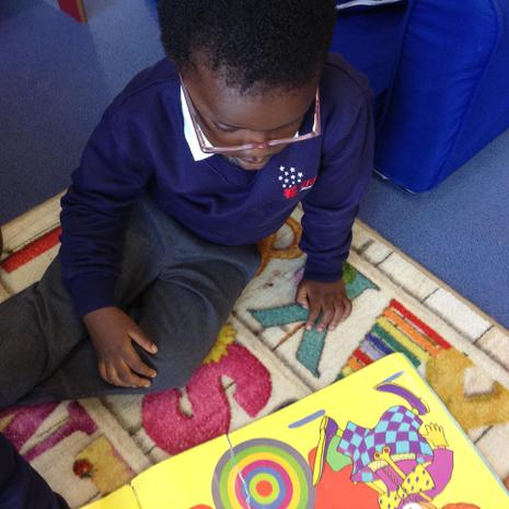 We are learning to look at books independently