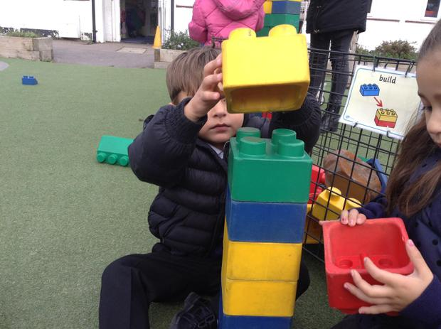 We have been building towers with large lego blocks