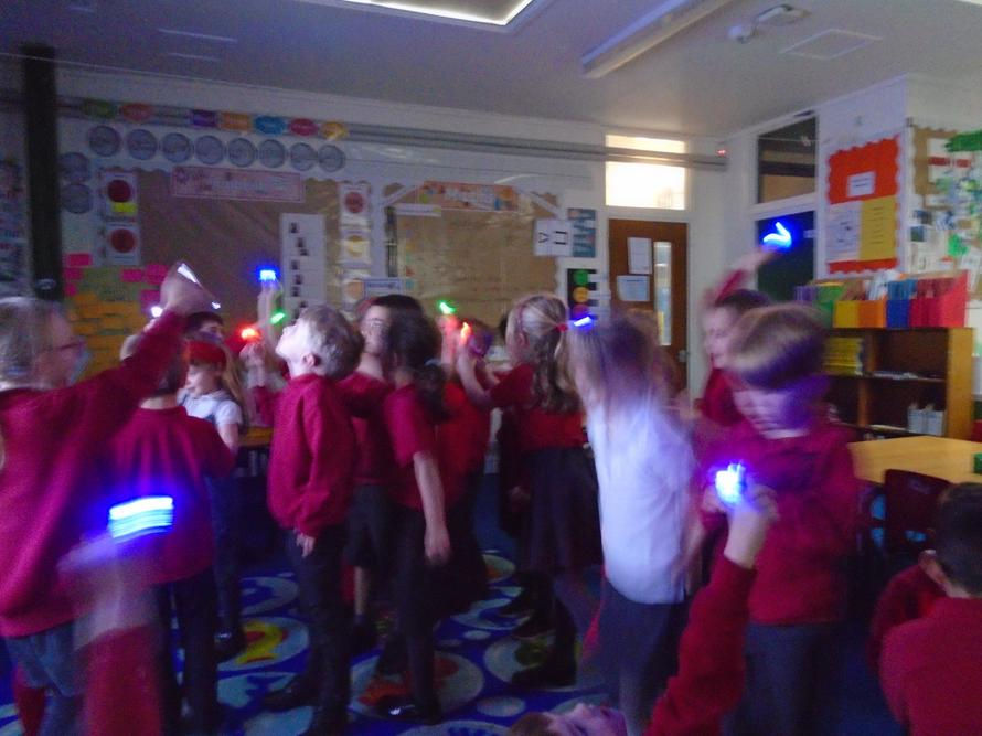 We played with mini finger torches experimenting with 'Light' in science