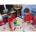 Strengthening our fingers with tweezer games