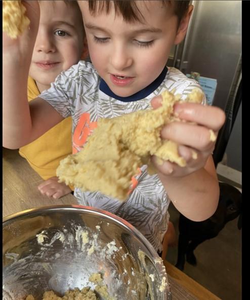 Team work making biscuits.