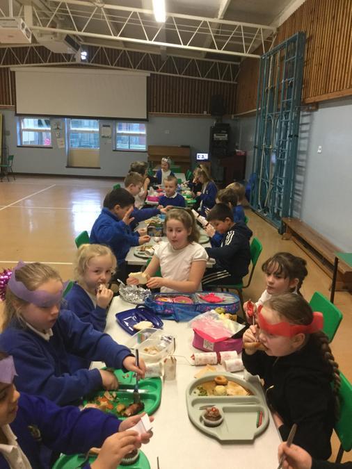 The children enjoying Christmas dinner.