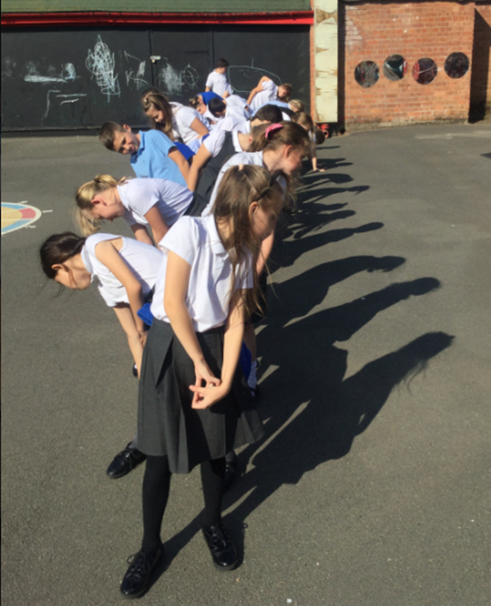 Whole class looking at their shadows in Science - Curiosity