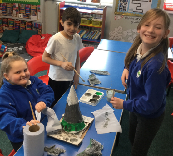 We followed instructions to build mountains out of paper mache.