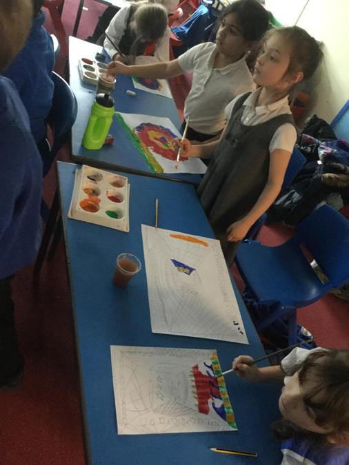 Mask design painting enjoyed by the children.