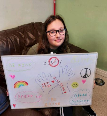 Alice with her poster when we were linking anti bullying with our Poem 'Still I rise'.