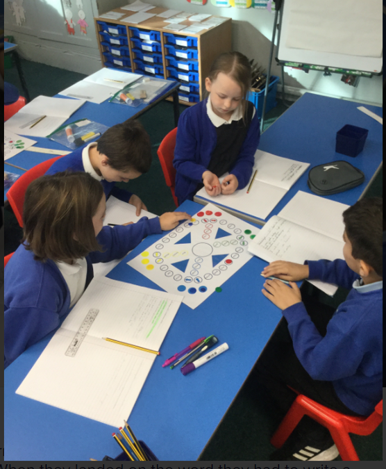 Year 4 spelling game - working in teams.  Writing sentences on common misconception words.